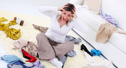 Woman overwhelmed with clutter